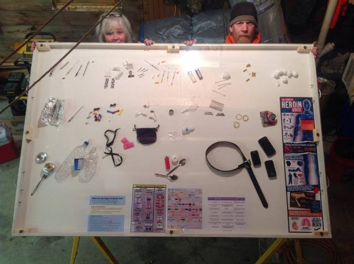Suzie and Gerald display the Wayne County Heroin Prevention Task Force display board: The Signs Someone You Care About Is Using Heroin